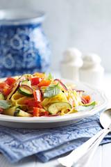 Tagliatelle with zucchini, pepper and red onion