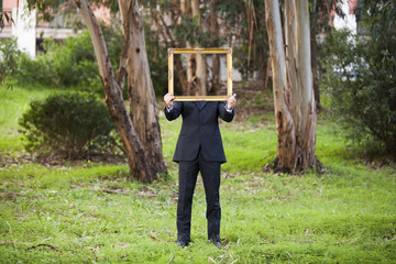 Anonynous businessman at the forest