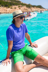 Young man enjoy summer vacation on boat