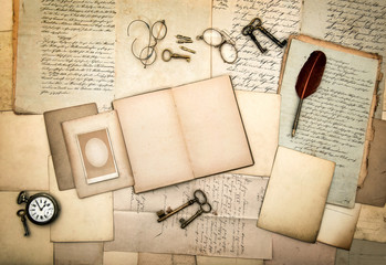 open diary book, old letters, picture frames, vintage accessorie