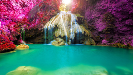 Ingelijste posters Watervallen wonderful waterfall with colorful tree in thailand