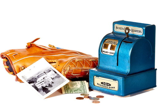 Coin bank with baseball glove, money and vintage photo