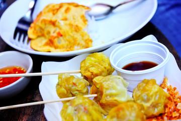 Dumpling with dipping sauce