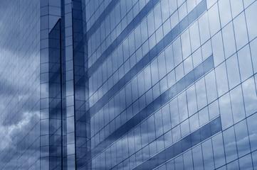Fototapete - Glass of modern tower, blue tone