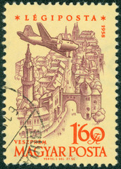 stamp printed by Hungary, shows Plane over Veszprem