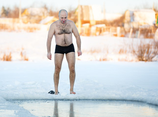 Fototapeta Winter-swimmer  ice-hole at lake