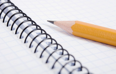 Blank notebook and pencil