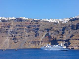 Wall Mural - Little cruise ship in Santorini, Greece