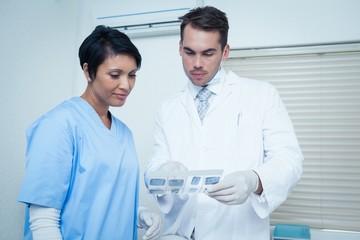Dentists looking at x-ray