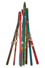 Vintage collection of used skis isolated on white