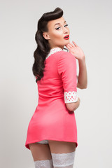 emotional sexy pin-up girl in coral dress