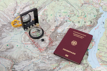 Compass and passport on a hiking map of the Berchtesgaden Alps
