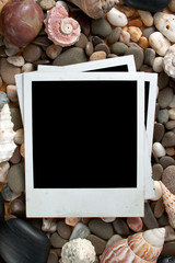 Retro photo framework against an sea stone and shell