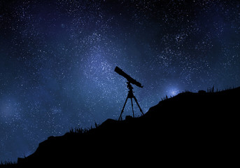 Starry sky with silhouette of telescope