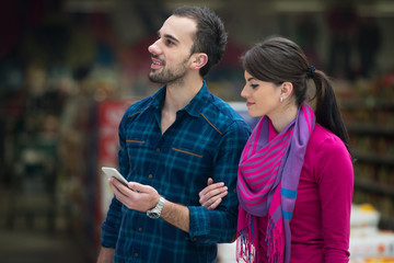 Couple At Groceries Store