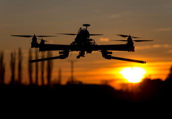 Hexacopter drone flying in the sunset