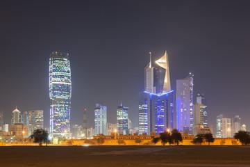 Skyline of Kuwait City illuminated at night, Middle East