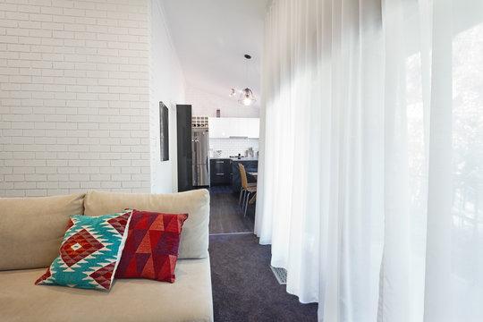 Modern living room sofa and sheer curtains horizontal