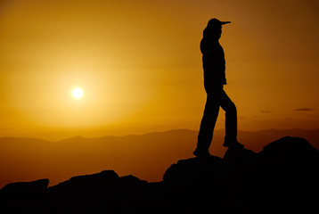 Man on a mountain in the evening