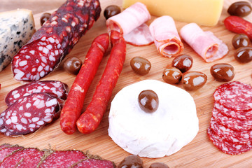 Wall Mural - Assortment of smoked sausages and cheese