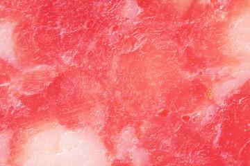 Fototapete - Slice of salami, macro view