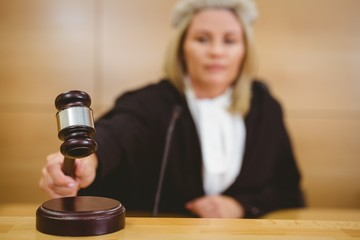 Serious judge with a gavel wearing robes and wig