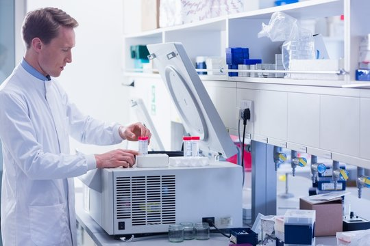 Focused chemist doing an experiment
