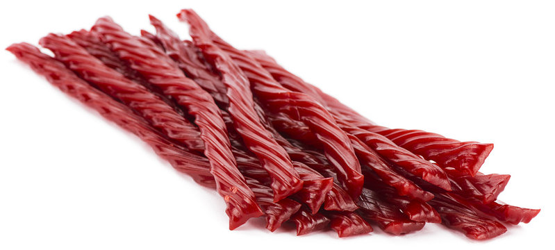 Red licorice candy shaped like a twisted rope isolated.