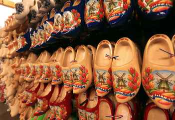 Poster - Dutch Souvenirs, a bunch of colored wooden shoes