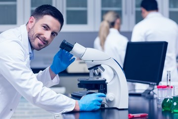 Science student working with microscope in the lab