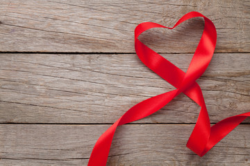 Heart shape ribbon over wood valentines day background