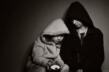 Homeless mother with her daughter. Poor family.