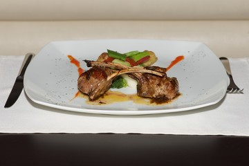 Lamb cutlets with vegetables and place setting
