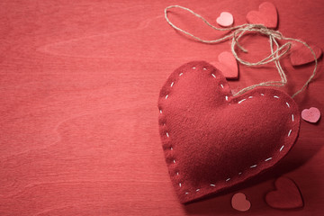 Textile toy in the shape of heart on Valentine's Day. Space for