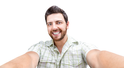 Happy young man taking a selfie photo isolated on white