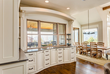 Kitchen Cabinets and Dining Room in New Luxury Home