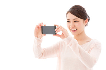 young asian woman taking photo