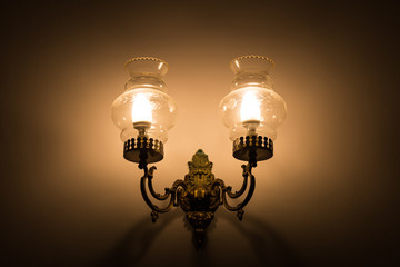 Vintage lamp illuminates a dark surrounding
