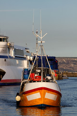 Fishing boat in Weymouth harbour early morning