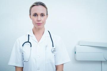 Portrait of serious female dentist