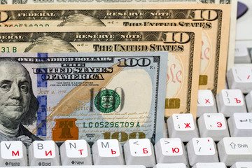 American dollars on a computer keyboard