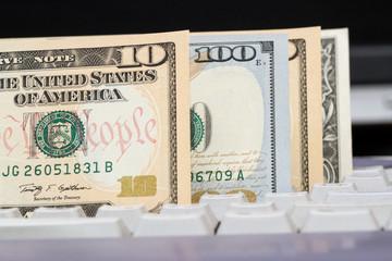 American dollars on a computer keyboard