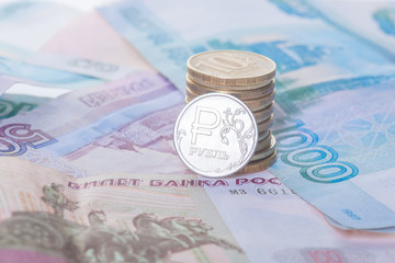 New russian ruble coin and banknotes