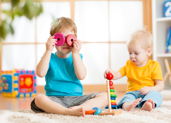children boys playing with educational toys