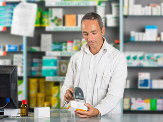 Handsome Pharmacist at Work in a Drugstore