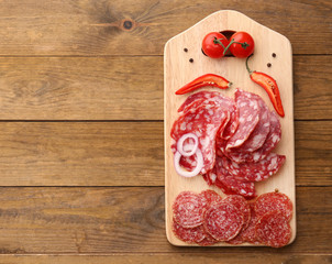 Fototapete - Sliced salami with chili pepper, onion and spices