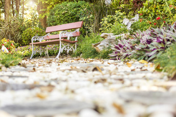 Art bench and garden in the morning