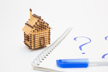 matchbox house, notebook with picture of question and pen