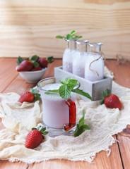 Strawberry milkshake on a rustic wooden table