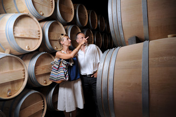 Tourism-Couple visiting a castle in the Bordeaux vineyard Wall mural